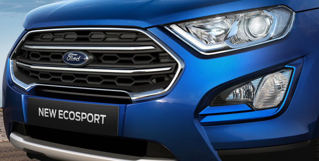 <strong>New Front End. Same Attitude.</strong><br /><span>EcoSport's refreshed grille, hood, and headlamps are sportier than ever.</span>